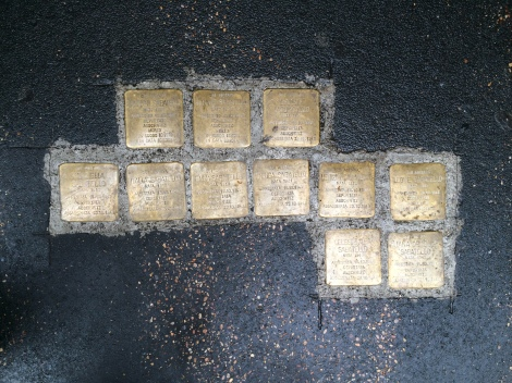 Memorial plaques in the sidewalk honoring those who were deported by Nazis and killed in concentration camps