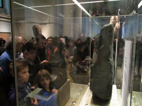 Gawking at the Rosetta Stone, along with several billion others