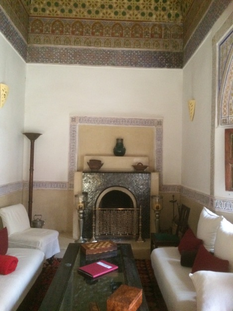 Riad staff set a cozy fire each night for us in this historic room with its gorgeous ceiling