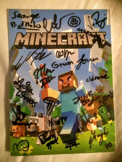 Minecraft card signed by staff - treasured by my kid.