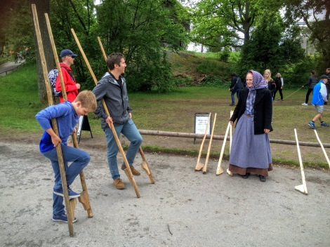 Trying out stilts at Skansen open air museum