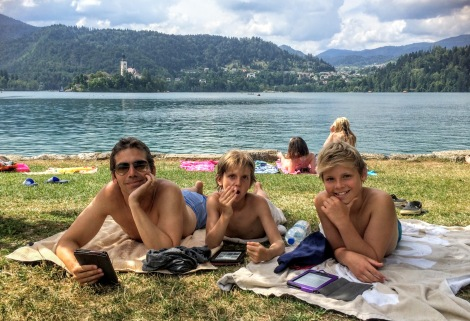 Reading & relaxing between dips at Lake Bled.